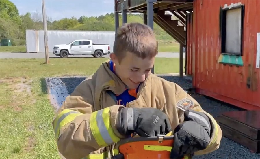 """Featured image for """"Firefighter Motivation as a Young Firefighter Tries Fire Hose Training with Senior Members"""""""
