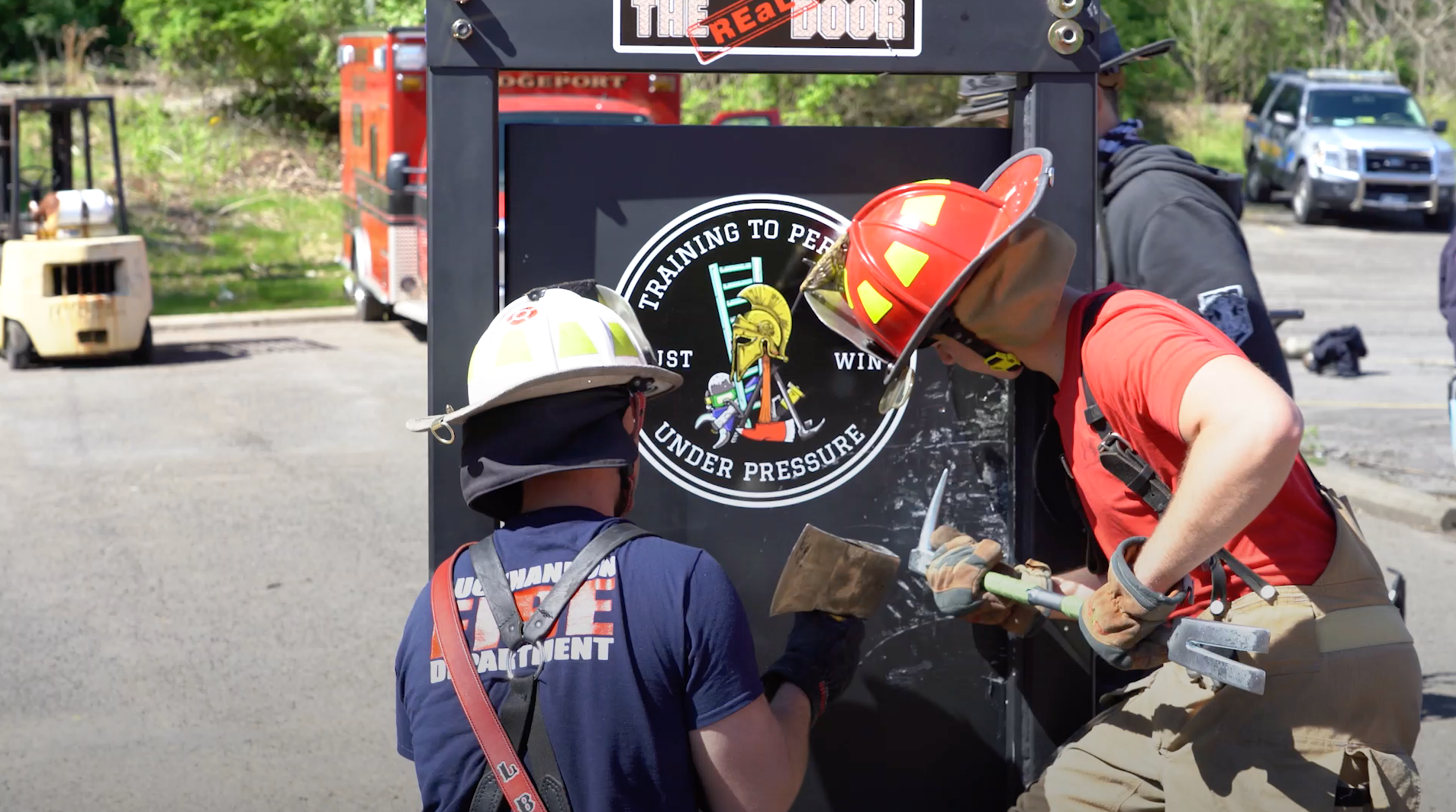 """Featured image for """"Instructor Provides Firefighter Forcible Entry Training, Showing Use of Forcible Entry Tools"""""""